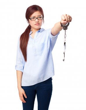 worried chinese woman with handcuffs