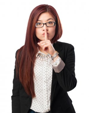 Happy chinese woman silence gesture