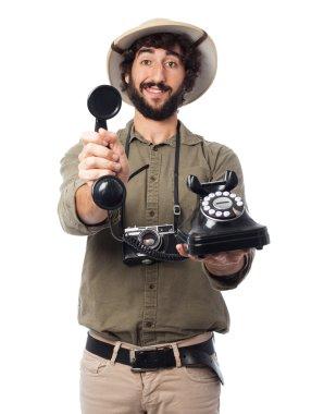 crazy explorer man with telephone