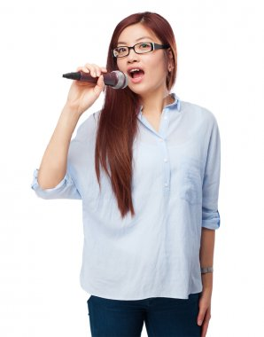 happy chinese woman with microphone