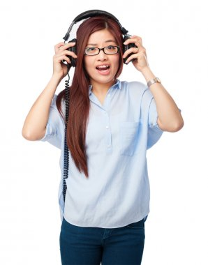 Shouting chinese woman with headphones
