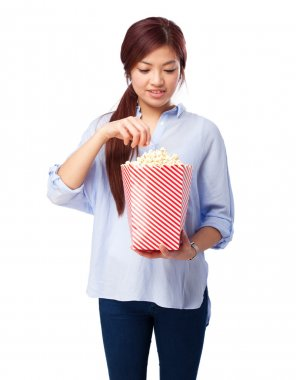 happy chinese woman with popcorn