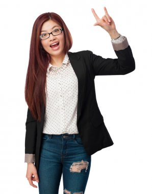 happy chinese woman rock gesture