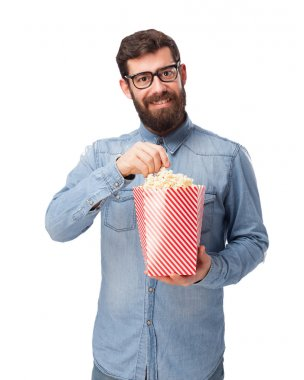 happy young man with popcorn