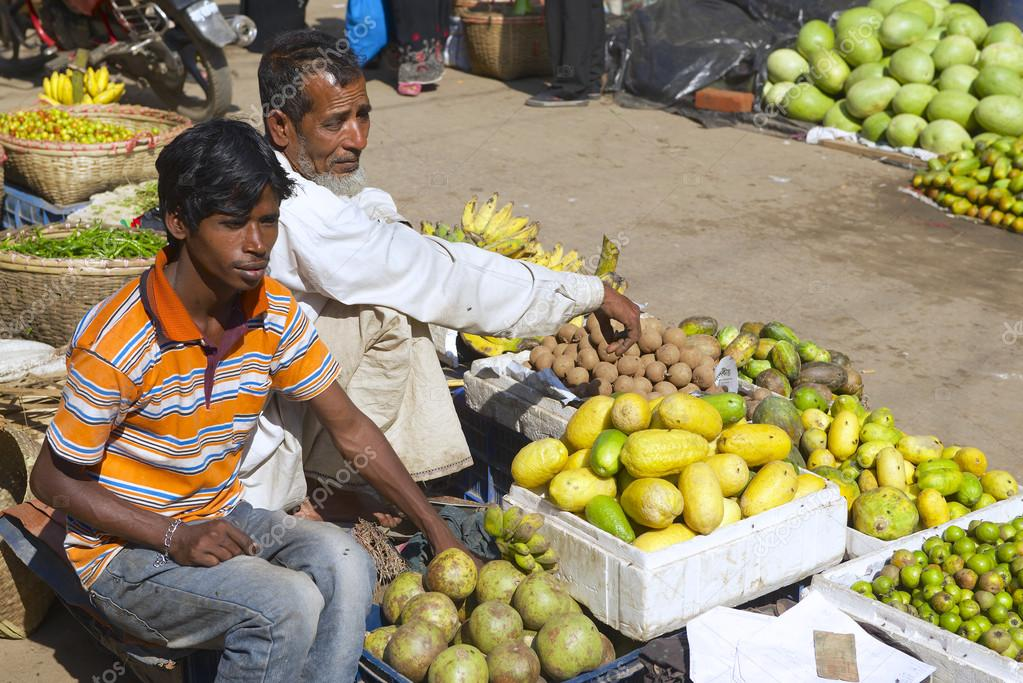 Men sell fruits at the local market in Bandarban, Bangladesh