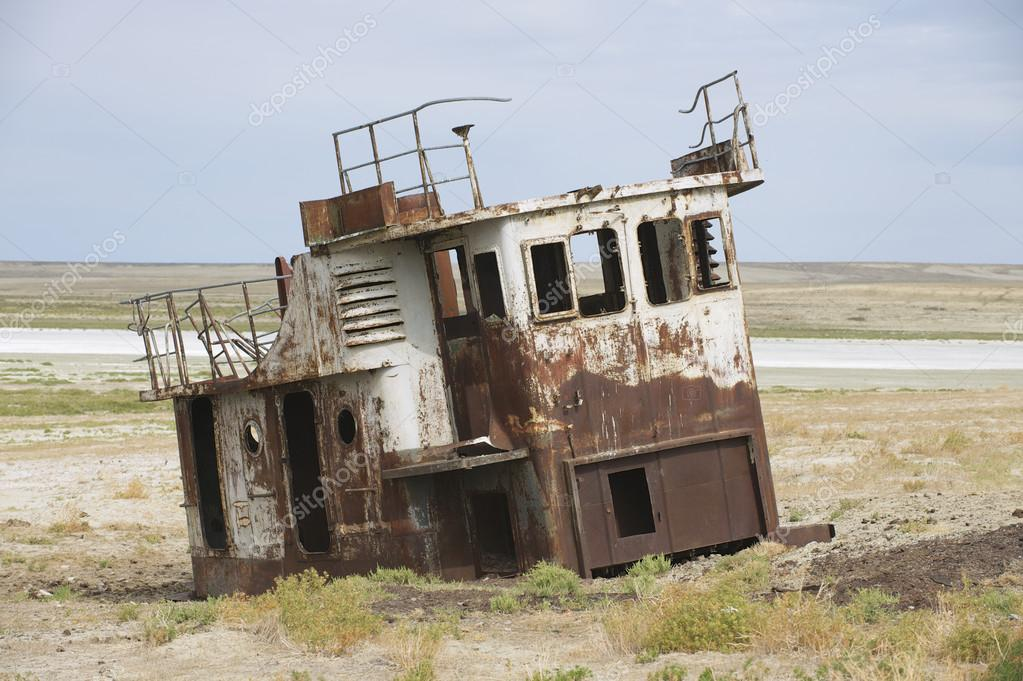 Rusted remains of fishing boats at the sea bed of the Aral sea, Aralsk, Kazakhstan.