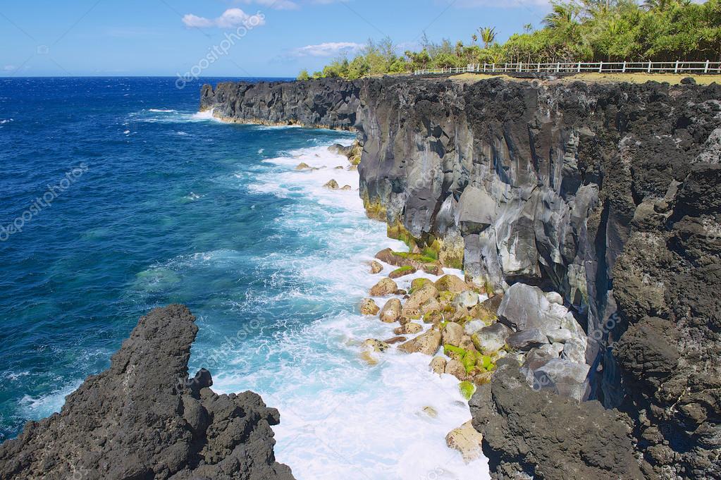 Black volcanic lava sea coast at Reunion island, France.