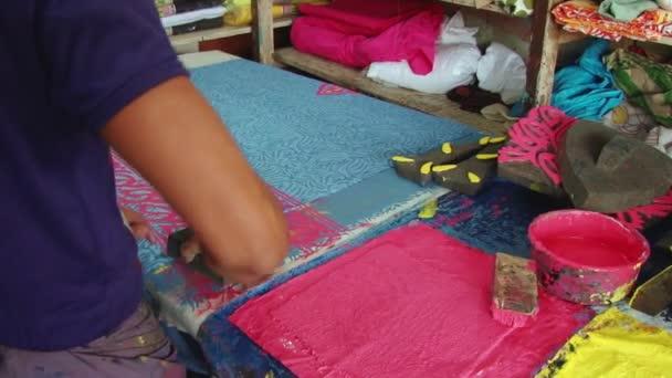 Man produces stamp print cloth at the workshop at the New Market in Dhaka, Bangladesh.