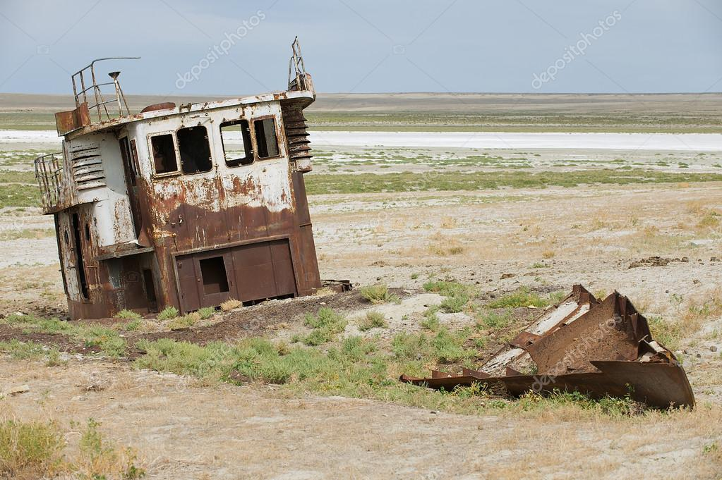 Rusted remains of fishing boat at the sea bed of the Aral sea, Aralsk, Kazakhstan.