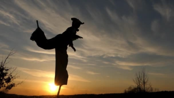 Stilt Walker Jumping on One Leg at Sunset. Beautiful Action in Slow Motion.
