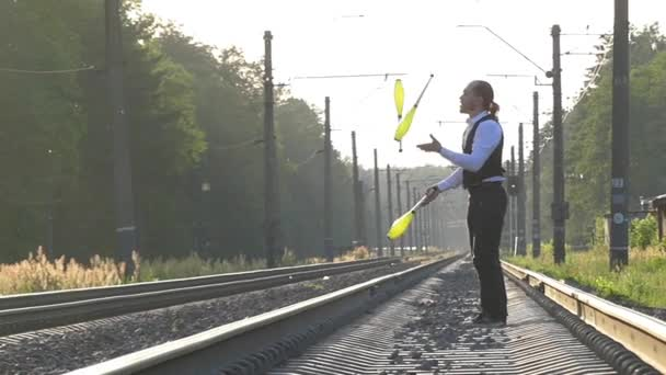Guy Juggling on the Train Tracks. Slow Motion. Fail.