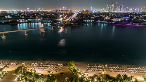 Jumeirah Palm island skyline night timelapse in Dubai, UAE.