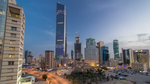 Skyline with Skyscrapers day to night timelapse in Kuwait City downtown illuminated at dusk. Kuwait City, Middle East