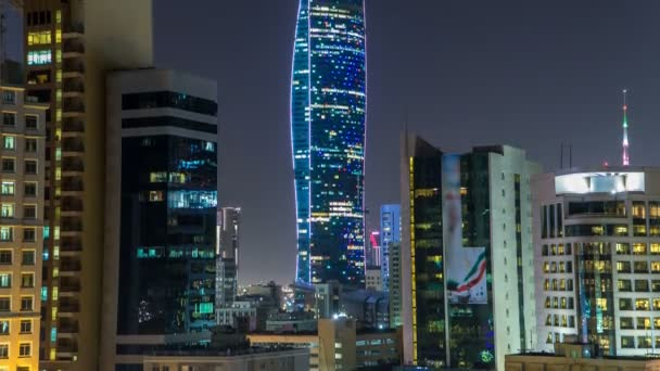 Skyline with Skyscrapers night timelapse in Kuwait City downtown illuminated at dusk. Kuwait City, Middle East