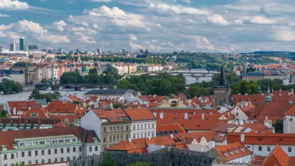 Panorama of Prague Old Town with red roofs timelapse, famous bridges and Vltava river, Czech Republic.