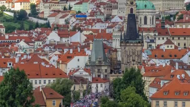 Charles Bridge Karluv Most and Lesser Town Tower timelapse, in the background St. Nicholas church and the castle