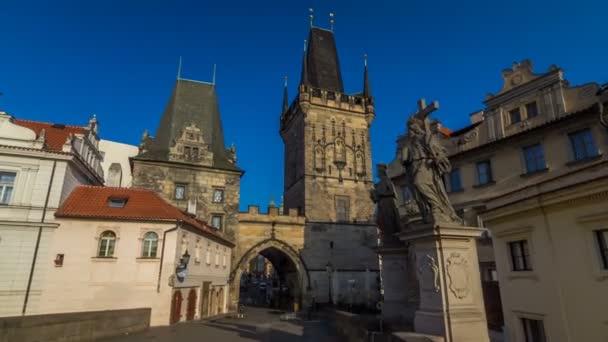 A view along Charles Bridge in Prague towards the Lesser Quarter in the morning timelapse hyperlapse.