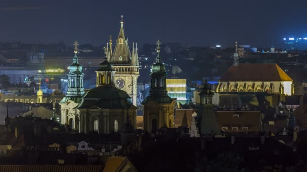 Prague night timelapse, fantastic old town roofs during twilight with towers and night illumination, Czech Republic