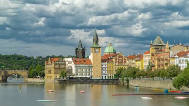 Charles Bridge and historical buildings timelapse in Prague from across the river. Staromestsky water tower. Prague, Czech Republic.
