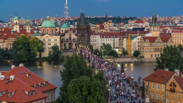 Scenic summer aerial view of the Old Town pier architecture and Charles Bridge over Vltava river day to night timelapse in Praha. Prague, Czech Republic.