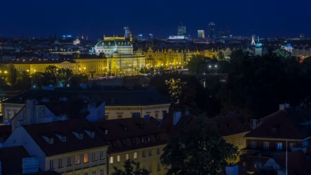 Illuminated National Theatre in Prague at night with reflection in Vltava River timelapse, Czech Republic