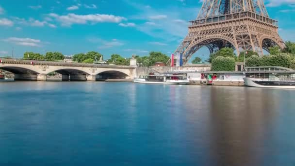 The Eiffel tower timelapse from embankment at the river Seine in Paris