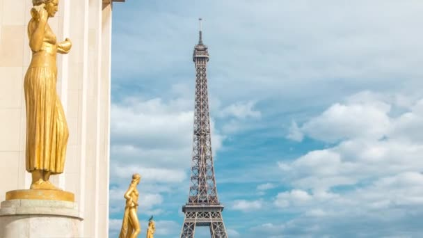 Eiffel Tower and the golden statues of women in the sun light timelapse, Trocadero square, Paris, France