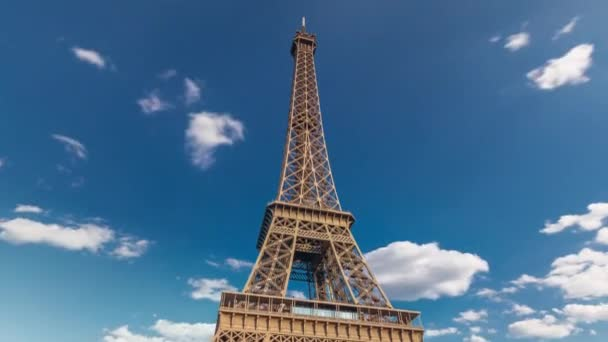 The Eiffel tower with warm light during sunset timelapse hyperlapse.