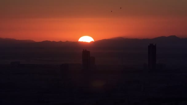 Sunrise in Dubai Marina with buildings and mountains from top of skyscrapper, Dubai, UAE timelapse