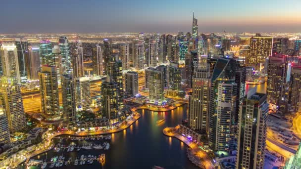 Dubai Marina with modern towers from top of skyscraper transition from day to night timelapse