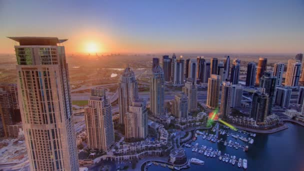 Sunrise in Dubai Marina with towers and harbor with yacht from skyscrapper, Dubai, UAE timelapse