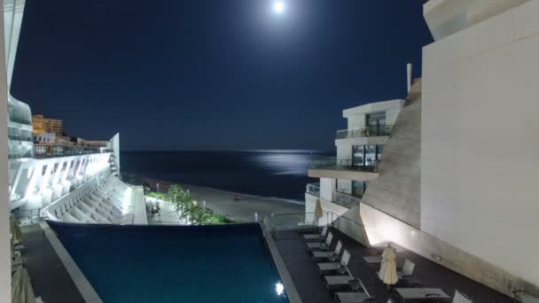 Night view from modern building of hotel, in Sesimbra, Portugal, timelapse