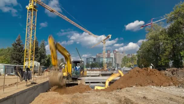 Yellow excavator on a construction site timelapse