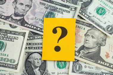 Question mark on dollar banknotes