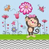 Fotografia Scimmia sveglia con un fiore