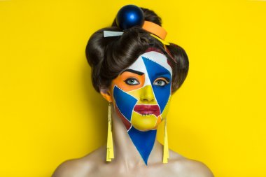 Bright shapes on face