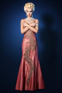 Beautiful woman make up hair style luxury pink dress