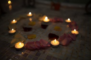 candles red pink yellow rose petals big heart
