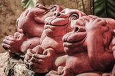 Three clay monkeys