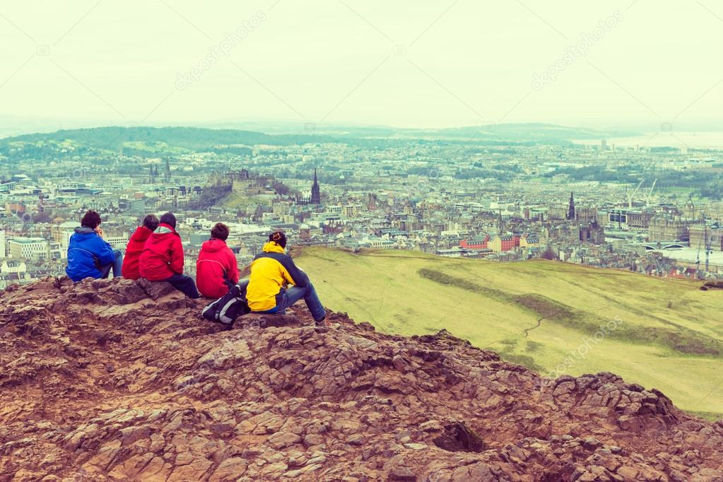 Family enjoying view of Edinburgh from top of Arthurs seat, ancient volcano, Scotland, UK