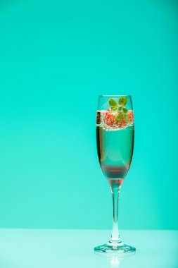 Champagne glass with strawberry, studio shot with light effects