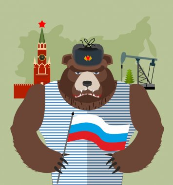 Bear with ear flaps with  flag of Russia. Background of  Moscow