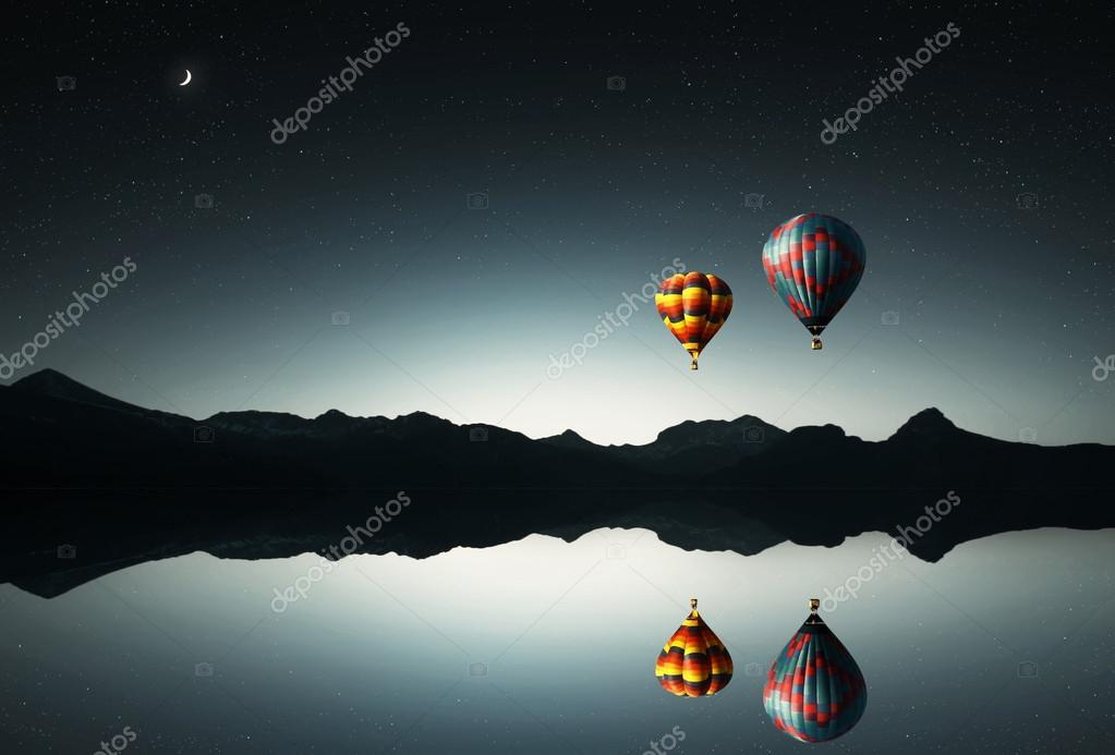 Balloons flying ver the water