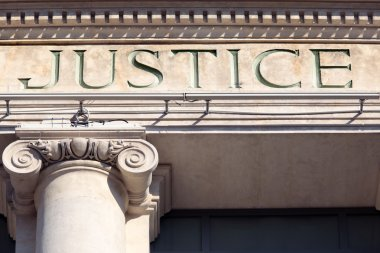Justice sign on a Courtroom Building.
