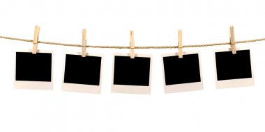 Several blank polaroid style instant photo print frames hanging