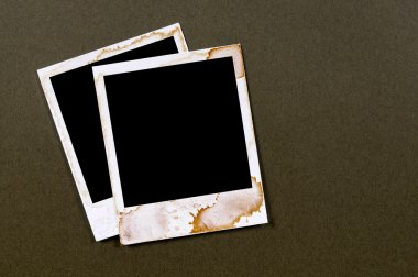 Two old vintage stained polaroid style blank photo print frames