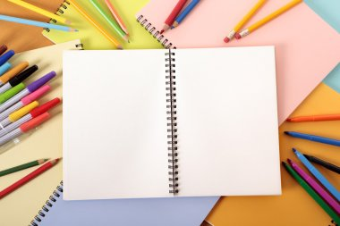 Student's desk with blank notebook
