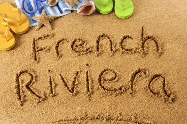 French Riviera beach writing