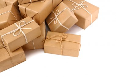 Untidy pile of brown parcels l