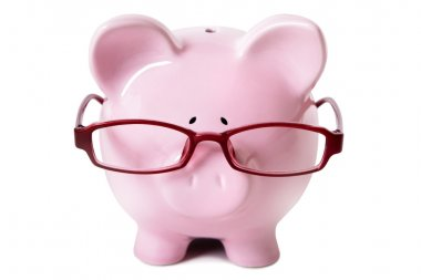 Pink piggy bank wearing glasses